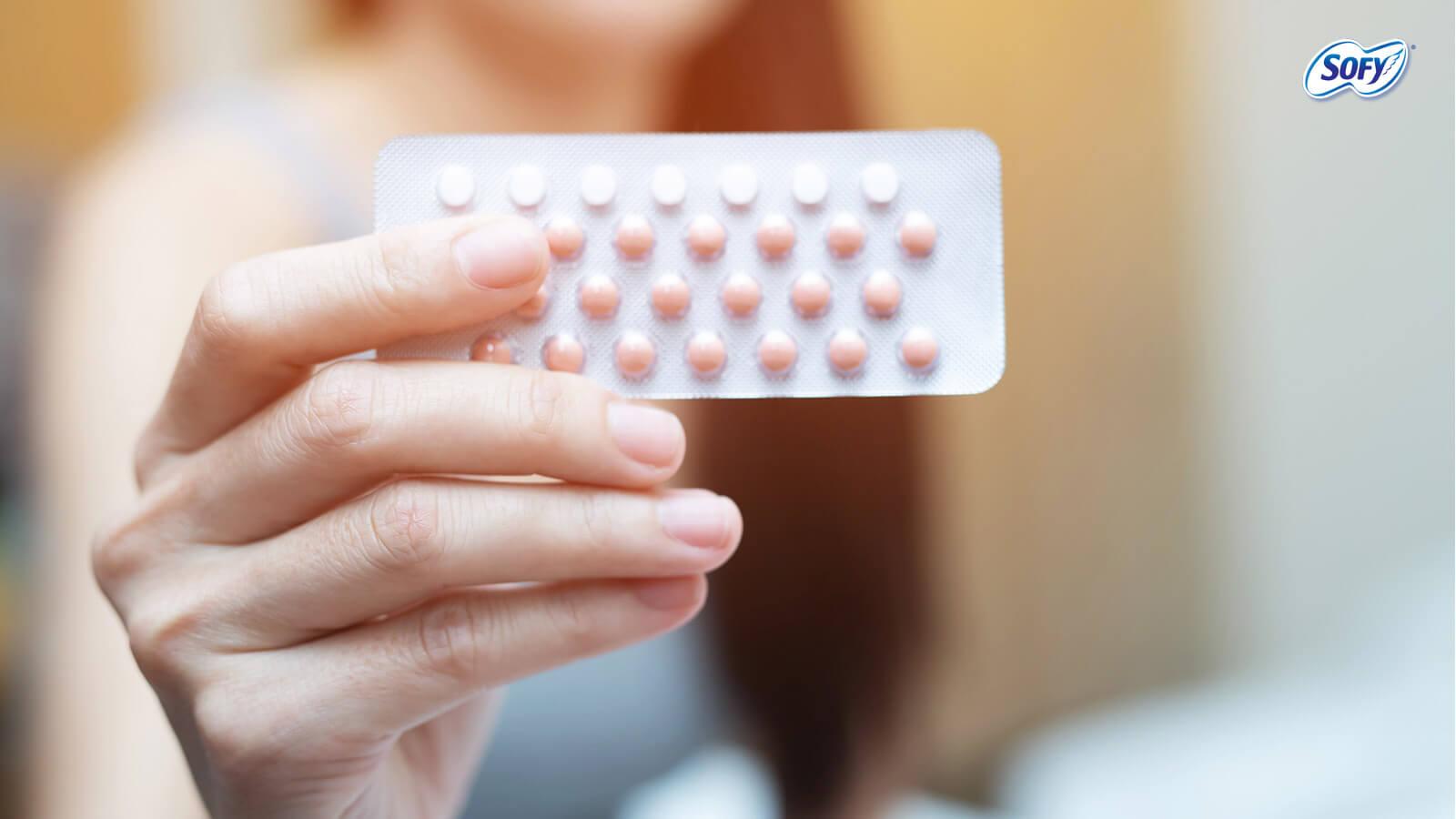 woman eating birth control pills